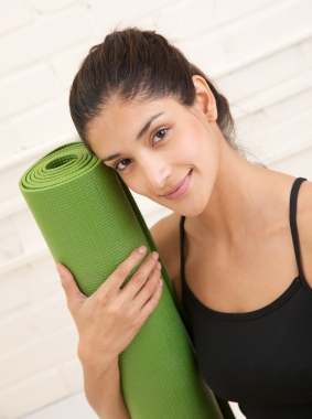 girl with yoga mat